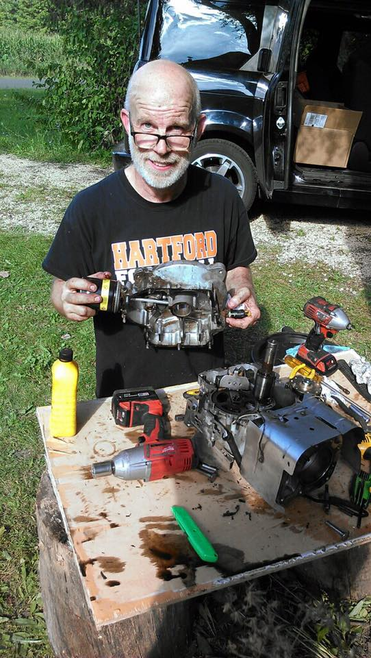 Greg, working on a Riding Mower engine